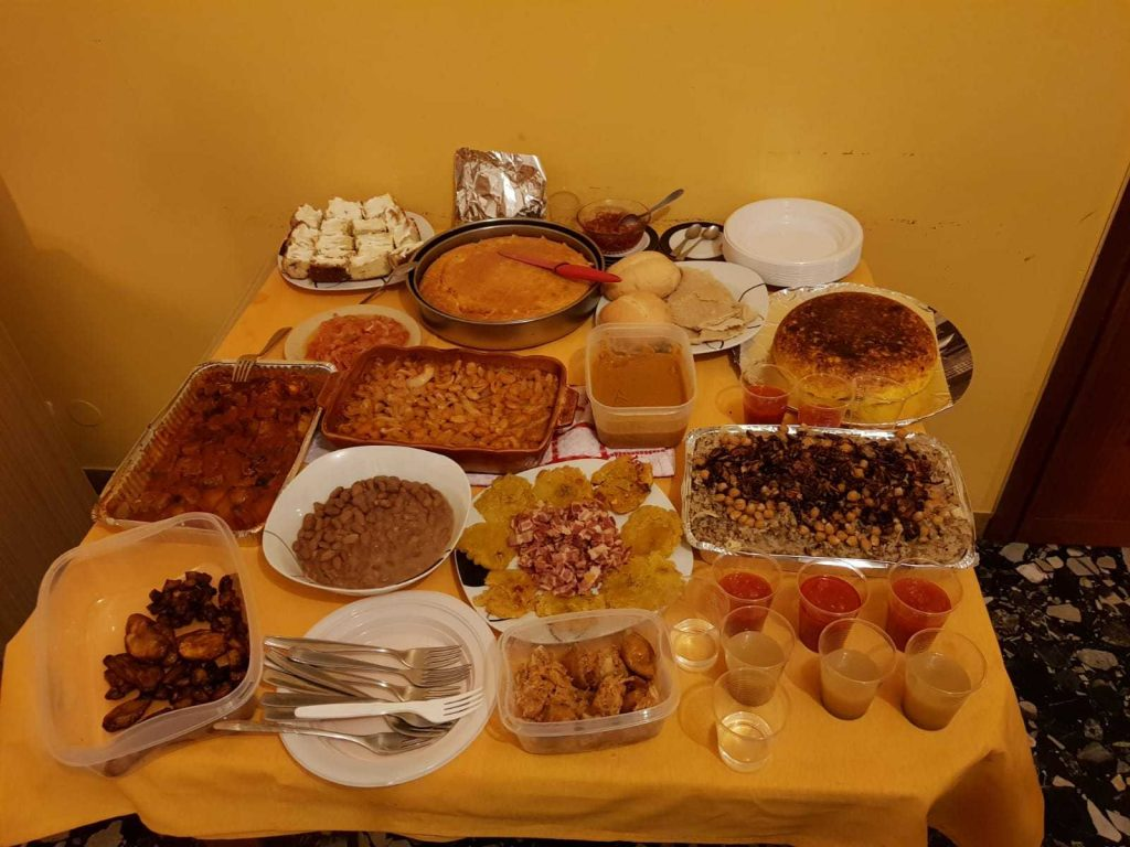 A laid table full of food from all around the world